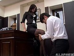 Mature Japanese woman in office clothes lies on a table and shows her sexy legs. Then she gets her feet and pussy licked by her employee.