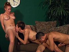 Natural tits makes her look sexy and that slut puts strap on and enjoys while that horny bisexual guy seats on it while sucks cock at same time.