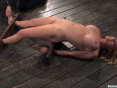 Blonde cutie Krissy Lynn is getting naughty with some guy in a basement. She lets the dude put her into irons and then gets her coochie beaten with a stick and stunningly fingered.