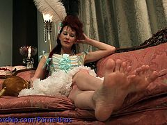 This maid was cleaning up in the room, but ended up shoving her feet in a cake. Her mistress ate the cake from her feet and fucked her ass hole with a strapon.