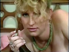Pregnant blonde milf Sahara Sands is getting naughty with some black stud indoors. She favours him with a blowjob and then they have sex in missionary position.