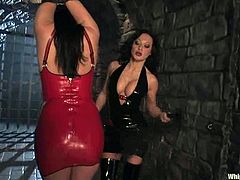 Horny dominatrix Sandra Romain is gonna teach Eva Angelina a good lesson. Sandra puts the hussy into irons and tortures her before smashing her snatch with a dildo.
