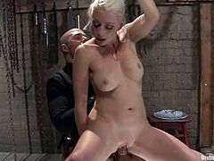 She doesn't give him much pain. All she does is she ties up David Chase and makes his cock get hard, riding and sucking it with passion!