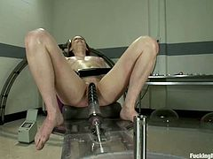 Slim and hot babe with pumps fixed to her tits gets her wet pussy stuffed by the fucking machine in a hospital.