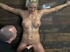 Adorable Holly Heart gets tied up and tortured with clothespins. After that the guy whips her feet and toys her wet pussy with big dildo.
