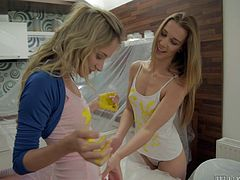 Look at these two sexy blonde painters. Unfortunately they are lesbians, but you can still watch them fuck. They finish painting the wall then rubs some paint of each other. This is great because now they have to take all their clothes off. Watch them strip and plays with each other's sexy naked bodies. These lesbos are so very hot.