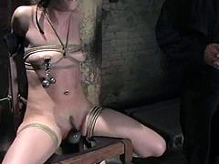 Submissive brunette chick in school uniform gets tie up and gagged. Later on she gets her nipples and pussy lips tortured.