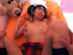 This petite asian chick looks so innocent in her sexy school uniform. She got her pussy fingered and it was ready to receive hardcore banging to get her covered in cum.