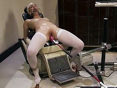 Petite blonde babe lies on a sofa being tied up. She gets her tight ass and vagina toyed by the fucking machine at the same time.