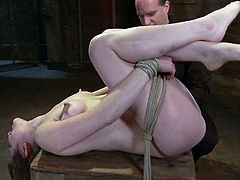 Hot brunette girl gets clothespinned and tied up by her master. Then she sucks massive dildo and gets her pussy torn up.