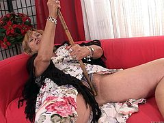 She's an old lady and although our granny uses a walking stick, she has more than one use for it! Steve grabs her walking stick and hooks her with it. He inserts the curved end in her hairy vagina and fucks the bitch. She likes that and get's turned so much, that she grabs his penis, and sucks it!