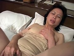 Watch this horny granny masturbates. She craves for a stiff cock, but she's alone. So she slides fingers in her pussy and then plugs her dildo deep inside her old cunt.