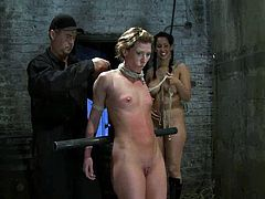 Tied up blonde chick gets her shaved pussy toyed by Isis Love. After that she also gets choked with ropes.