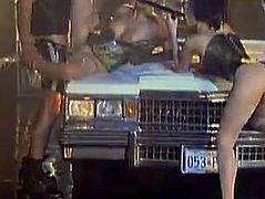 Amazing girls in sexy lingerie have an amazing sex with guy in police uniform on a Lincoln Continental. They suck his big cock and get fucked on a car hood.
