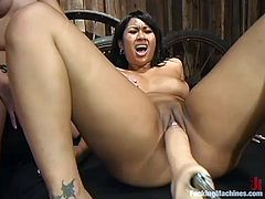 ChynaWhite and DragonLily take their clothes off and then get their tight Asian pussies toyed by fucking machines.