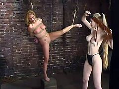 Jenni Lee the sexy blonde babe gets tied up in some dungeon by her horny mistress. Later on Jenni gets whipped painfully.