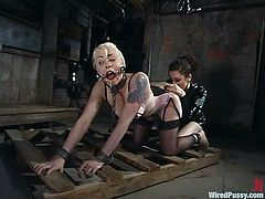 Blonde girl gets dominated by brunette mistress. Later on she gets her ass stimulated with electricity and pussy drilled with big dildo. Then she also gets whipped painfully.