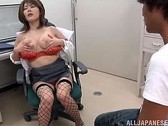 Hot Japanese milf is getting naughty with her man in an office. She allows the guy to watch her kneading her massive natural tits and cunt and then pleases him with a blowjob and a titjob.