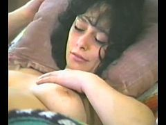 Have a look at this vintage video where this horny mom shows off her sexy body before being eaten out and masturbates by another hottie.