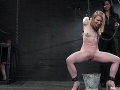 Charming redhead chick Madison Young is having fun with Isis Love in a basement. She lets the dominatrix bind her and then gets her snatch rubbed hard with a dildo.