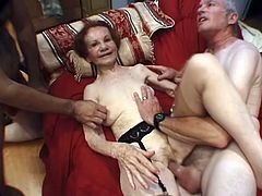 Kinky redhead granny Gigi is playing dirty games with two studs. She sucks and rubs their pricks devotedly and then gets her flabby snatch unforgettably drilled.