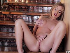 Tempting blonde with flawless body Angela Sommers pleasuring her self. Watch her bring herself to a nice and strong orgasm.