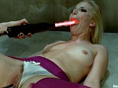 Sexy Ashley lies down on the floor and shows her hot pussy in close-up scenes. Later on she gets her vagina stuffed with electro dildo by Lorelei.