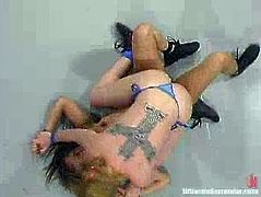 Blonde chick gets a victory against Latin girl. So, Annie sucks a strap-on like it is real dick and gets her vagina drilled from behind.