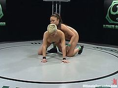 Short-haired blonde Syd Blakovich is having a fight with Annie Cruz on tatami. The girls struggle with each other ardently and then Syd bangs Annie's cunt with a toy.
