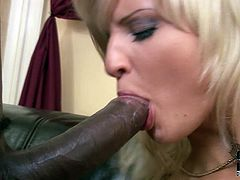 This sex-starved nympho needs a massive, black cock to satisfy her lust. She sucks that rock hard erection with unbridled passion like a dirty whore. A bit later he fucks her hairy pussy from behind.