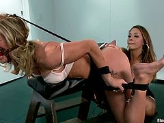 Horny blonde girl gets tied up and gagged by hot brunette. Later on this blondie gets her vagina drilled with electro dildo.