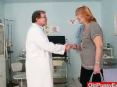 Check out horny redheaded czech granny spreading her legs wide for her gynecologist. He uses various toys and a speculum to chech if everything is alright with her cunt.