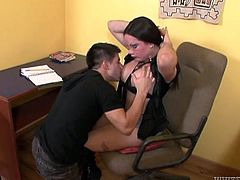 Lusty black haired secretary as a secret under her panties. It's a fat cock and shemale loves when her coworker gives her sloppy blowjob right at the workplace.