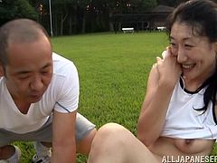 Slutty mature Japanese lady is having fun with her husband in the garden. They have oral sex in 69 position and then fuck ardently on the grass.