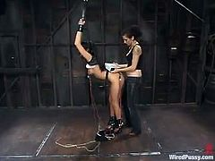 Roxy DeVille is having fun with Princess Donna Dolore in a basement. Princess binds Roxy, attaches wires to her body and then smashes her vag with a dildo.