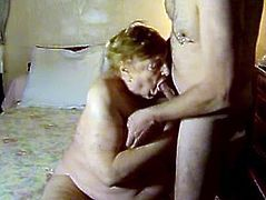 Obese granny Marge is having fun with some man in a bedroom. She gets fondled by the dude and then gets her fleshy old pussy fingered and fucked with a dildo.