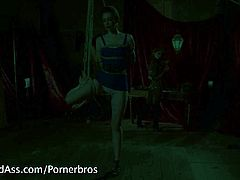 Sexy redhead with perfectly round ass is spanked and she's flogged.Her perky little nipples are tortured and she is made to get her mistress off.legs open and her pussy is penetrated with a strapon while her ass is plugged with cold metal.Lastly she's bound and bent over and fucked in her tight naive ass.