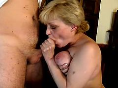 Mature blonde hottie called Tess is playing dirty games with some guy indoors. She drives the man crazy with a blowjob and then they fuck in cowgirl and side-by-side positions.