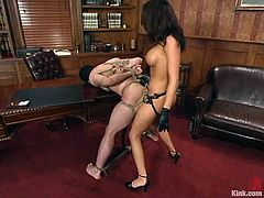 Stunning chick ties Wolf Lotus up and then whips his ass painfully. After that he licks her pussy and gets fucked with a strap-on.