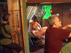 Pretty pale blonde with perfectly shaped firm boobs and muscled dude in shirt get filmed in pint of view in backstage while preparing to film hardcore scene in studio.