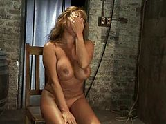 Busty chick gets gagged and tied up. Later on the guy undresses her and toys her vagina with a vibrator.