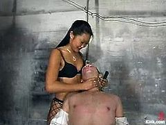 Lucy Lee is the girl dominating a guy in this video, torturing his cock and strapon fucking his ass in this femdom BDSM vid.