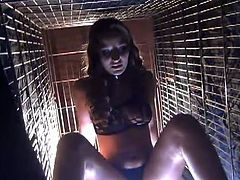 Stunning Dani Daniels is ready for some bdsm action and she is enslaved into a cage. Her master makes her to wear a leather mask and wants her to follow his commands.