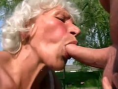 Cock-hungry old bitch Stella is having fun in the yard. She fingers her fugly hairy cunt and then smashes it with many toys.