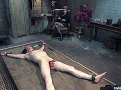 Skinny guy gets tied up by Aiden Starr and Cherry Torn. Then he his dick tortured and ass destroyed with a strap-on.