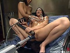 Brunette bombshells Isis Love and Satine Phoenix are having fun indoors. The hotties caress each other and then get their coochies smashed by a fucking machine.