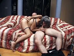 Salacious grey-haired granny is playing dirty games with some man indoors. She admires the stud with her cock-sucking talent and then they fuck in the reverse cowgirl and other positions.
