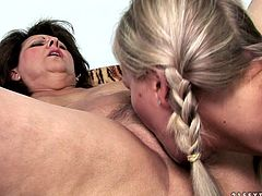 Petite blonde chick with cute face gets naughty with one BBW lesbian granny. Old fat whore opens her thick legs wide and gets her dirty hairy snatch licked and finger fucked.