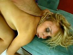 This video has a cute blonde bitch taking some cock doggystyle and she is loving every second of it. She is taking all that is offered.