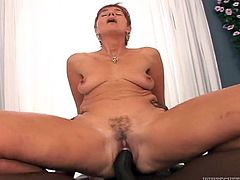 Press play on this hardcore interracial video and watch this horny granny end up filled by warm cum after being fucked by a big black cock.